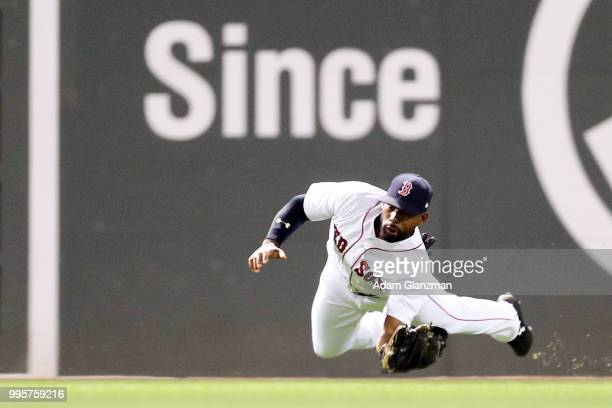 Jackie Bradley Jr #19 of the Boston Red Sox makes a diving catch in the sixth inning of a game against the Texas Rangers at Fenway Park on July 10...