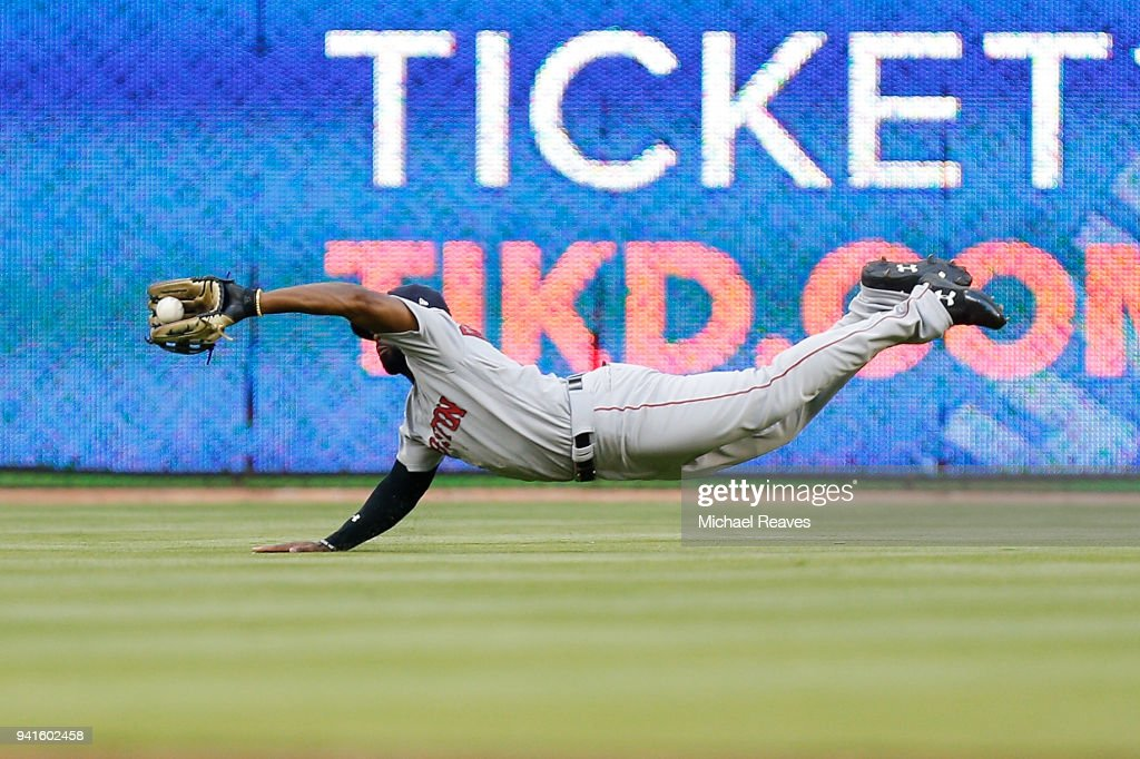 Jackie Bradley Jr. #19 of the Boston Red Sox makes a diving catch during the second inning against the Miami Marlins at Marlins Park on April 3, 2018 in Miami, Florida.