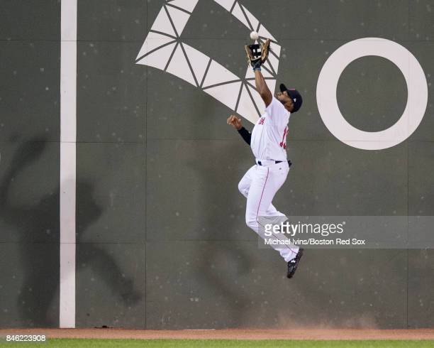 Jackie Bradley Jr #19 of the Boston Red Sox makes a leaping catch on a fly ball hit by Marcus Semien of the Oakland Athletics in the fifth inning at...