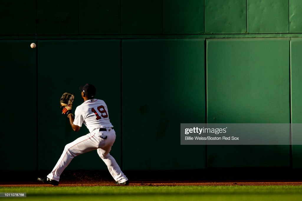 Jackie Bradley Jr. #19 of the Boston Red Sox plays a ball off the wall during the ninth inning of a game against the New York Yankees on August 4, 2018 at Fenway Park in Boston, Massachusetts.