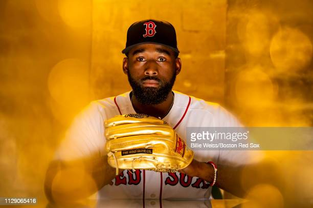 Jackie Bradley Jr #19 of the Boston Red Sox poses for a portrait with the Gold Glove award during a team workout on February 27 2019 at JetBlue Park...