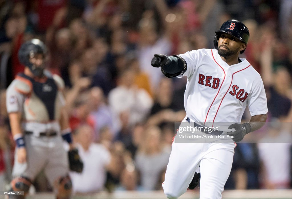Jackie Bradley Jr. #19 of the Boston Red Sox reacts after a two-run home run against the Detroit Tigers in the ninth inning at Fenway Park on June 9, 2017 in Boston, Massachusetts.