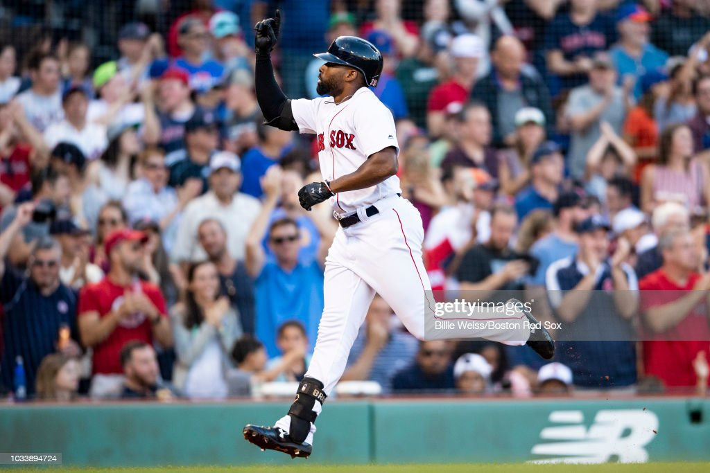Jackie Bradley Jr. #19 of the Boston Red Sox reacts after hitting a home run that was reviewed and overruled as a ground rule double during the fifth inning of a game against the New York Mets on September 15, 2018 at Fenway Park in Boston, Massachusetts.