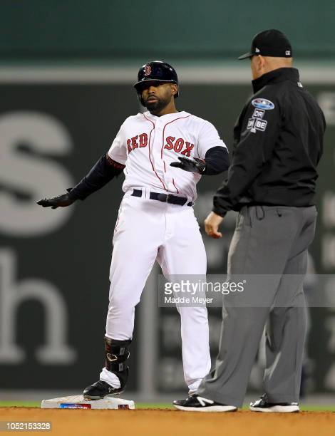 Jackie Bradley Jr #19 of the Boston Red Sox reacts after hitting a threerun double during the third inning against the Houston Astros in Game Two of...