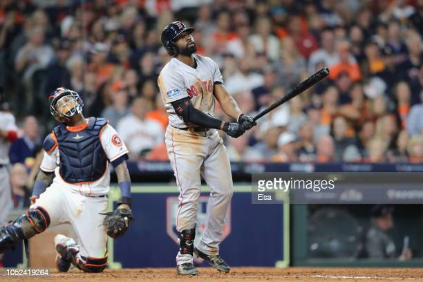 Jackie Bradley Jr #19 of the Boston Red Sox reacts after hitting a tworun home run in the sixth inning against the Houston Astros during Game Four of...