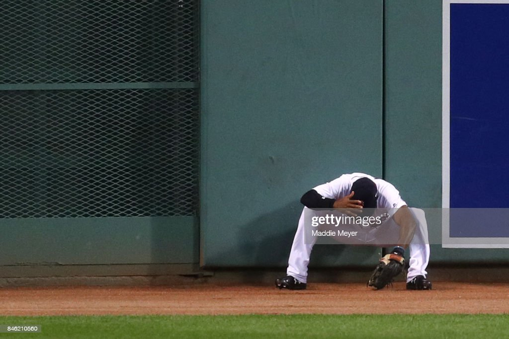 Jackie Bradley Jr. #19 of the Boston Red Sox reacts after jumping for a double hit by Jed Lowrie #8 of the Oakland Athletics during the first inning at Fenway Park on September 12, 2017 in Boston, Massachusetts.