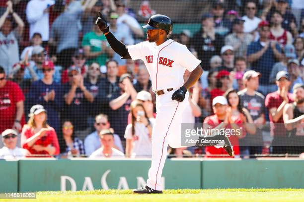 Jackie Bradley Jr. #19 of the Boston Red Sox reacts as he crosses home plate after hitting a solo home run in the eighth inning during game one of a...