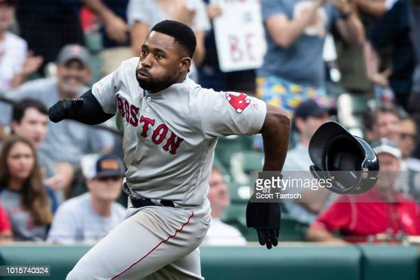 Jackie Bradley Jr #19 of the Boston Red Sox scores against the Baltimore Orioles during the ninth inning at Oriole Park at Camden Yards on August 12...