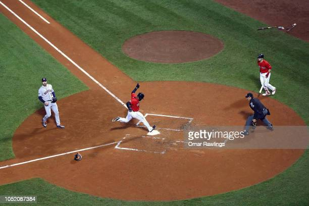 Jackie Bradley Jr #19 of the Boston Red Sox scores on a wild pitch during the fifth inning against the Houston Astros in Game One of the American...