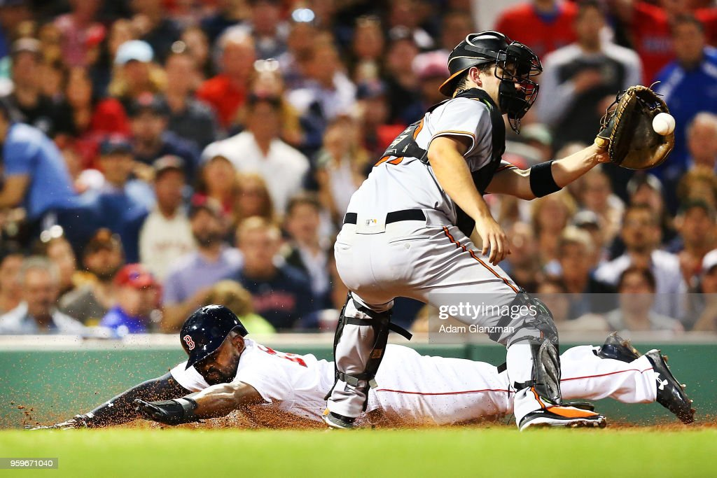 Jackie Bradley Jr. #19 of the Boston Red Sox slides safely past the tag of Andrew Susac #27 of the Baltimore Orioles in the fifth inning of a game at Fenway Park on May 17, 2018 in Boston, Massachusetts.