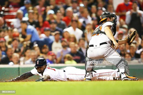 Jackie Bradley Jr #19 of the Boston Red Sox slides safely past the tag of Andrew Susac of the Baltimore Orioles in the fifth inning of a game at...