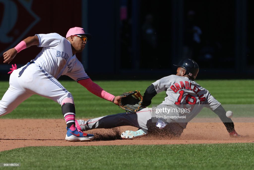 Jackie Bradley Jr. #19 of the Boston Red Sox steals second base as Yangervis Solarte #26 of the Toronto Blue Jays tries to make the tag in the ninth inning during MLB game action at Rogers Centre on May 13, 2018 in Toronto, Canada.