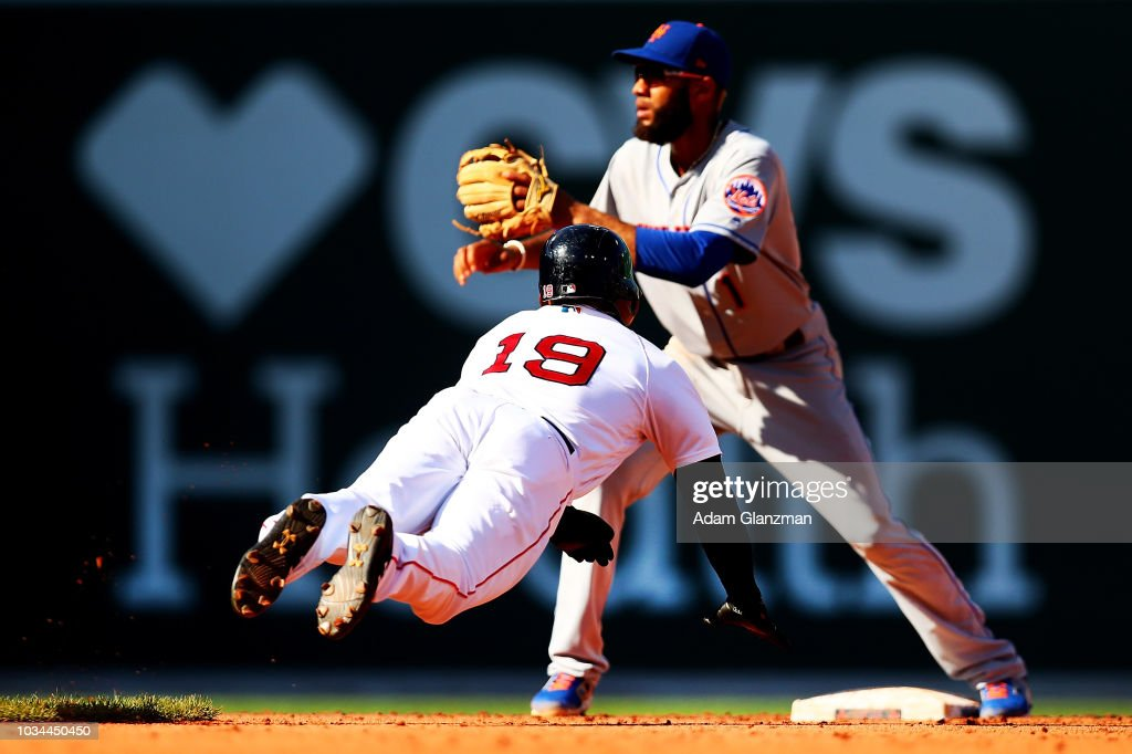 Jackie Bradley Jr. #19 of the Boston Red Sox steals second base under the tag of Amed Rosario #1 of the New York Mets in the seventh inning of a game at Fenway Park on September 16, 2018 in Boston, Massachusetts.