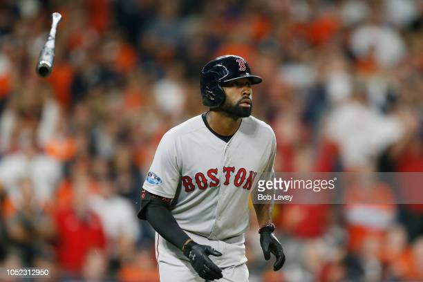 Jackie Bradley Jr #19 of the Boston Red Sox tosses his bat after hitting a grand slam home run in the eighth inning against the Houston Astros during...