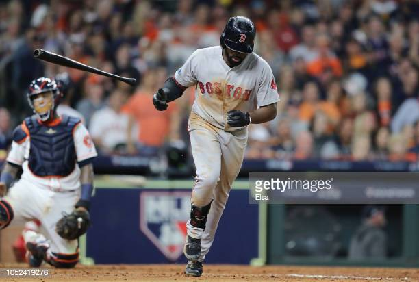 Jackie Bradley Jr #19 of the Boston Red Sox tosses his bat after hitting a tworun home run in the sixth inning against the Houston Astros during Game...