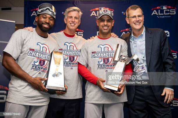 Jackie Bradley Jr #19 poses with the American League Championship Series Most Valuable Player Trophy alongside President of Baseball Operations Dave...