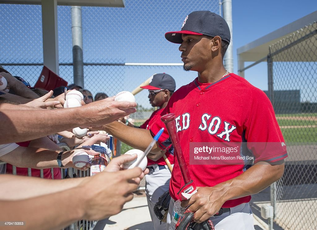 Jackie Bradley Jr. #25 and Xander Bogaerts #2 of the Boston Red Sox sign autographs following a Spring Training workout at Fenway South on February 19, 2014 in Fort Myers, Florida.