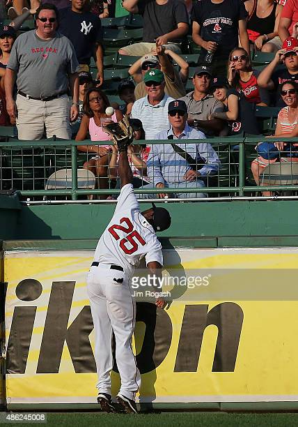 Jackie Bradley Jr. #25 of the Boston Red Sox cannot reach a home run hit by Didi Gregorius of the New York Yankees in the fifth inning at Fenway Park...