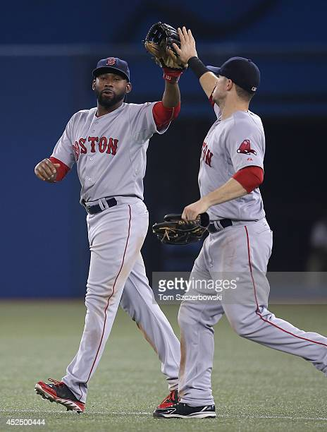 Jackie Bradley Jr #25 of the Boston Red Sox celebrates their victory with Daniel Nava during MLB game action against the Toronto Blue Jays on July 21...