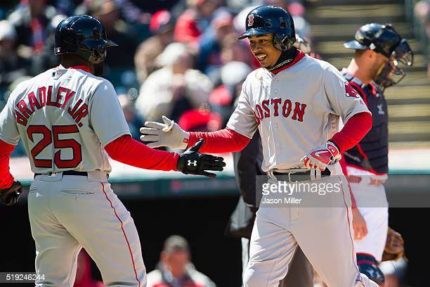 Jackie Bradley Jr #25 of the Boston Red Sox celebrates with teammate Mookie Betts after both scored on a home run by Betts during the third inning of...