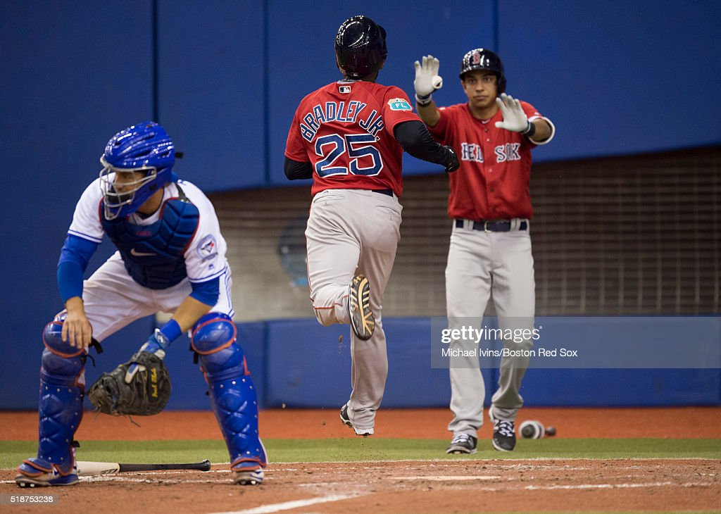 Jackie Bradley Jr. #25 of the Boston Red Sox crosses home plate against the Toronto Blue Jays in the fifth inning on April 2, 2016 at Olympic Stadium in Montreal, Quebec.