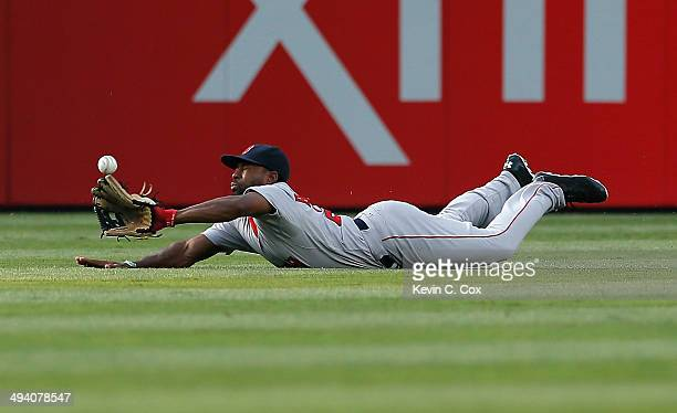Jackie Bradley Jr. #25 of the Boston Red Sox dives as he fails to catch a line drive by Gerald Laird of the Atlanta Braves in the second inning at...