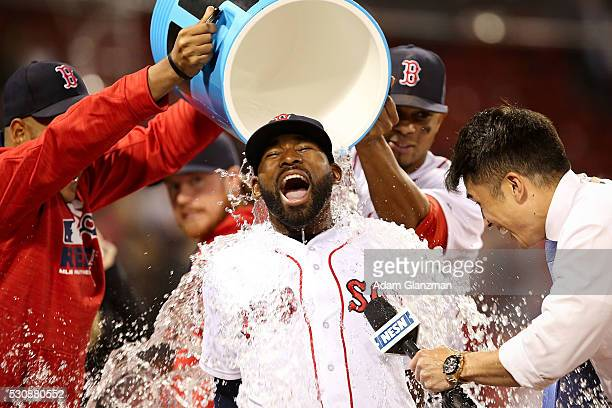 Jackie Bradley Jr #25 of the Boston Red Sox has Powerade dumped on him after the victory over the Oakland Athletics at Fenway Park on May 11 2016 in...