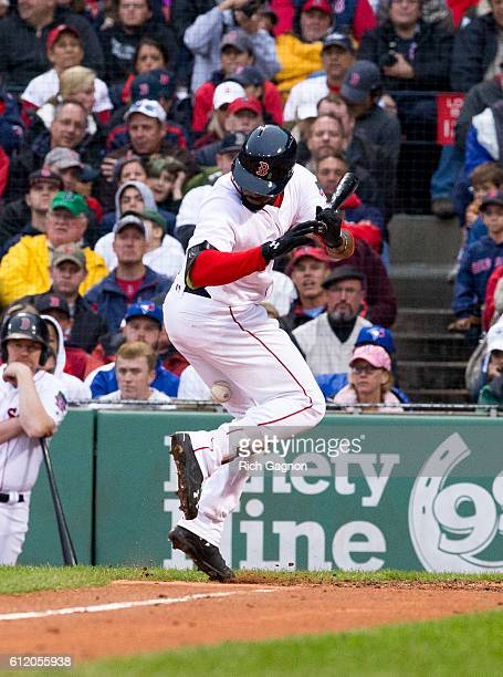 Jackie Bradley Jr #25 of the Boston Red Sox is hit by a pitch thrown by Aaron Sanchez of the Toronto Blue Jays during the fourth inning at Fenway...
