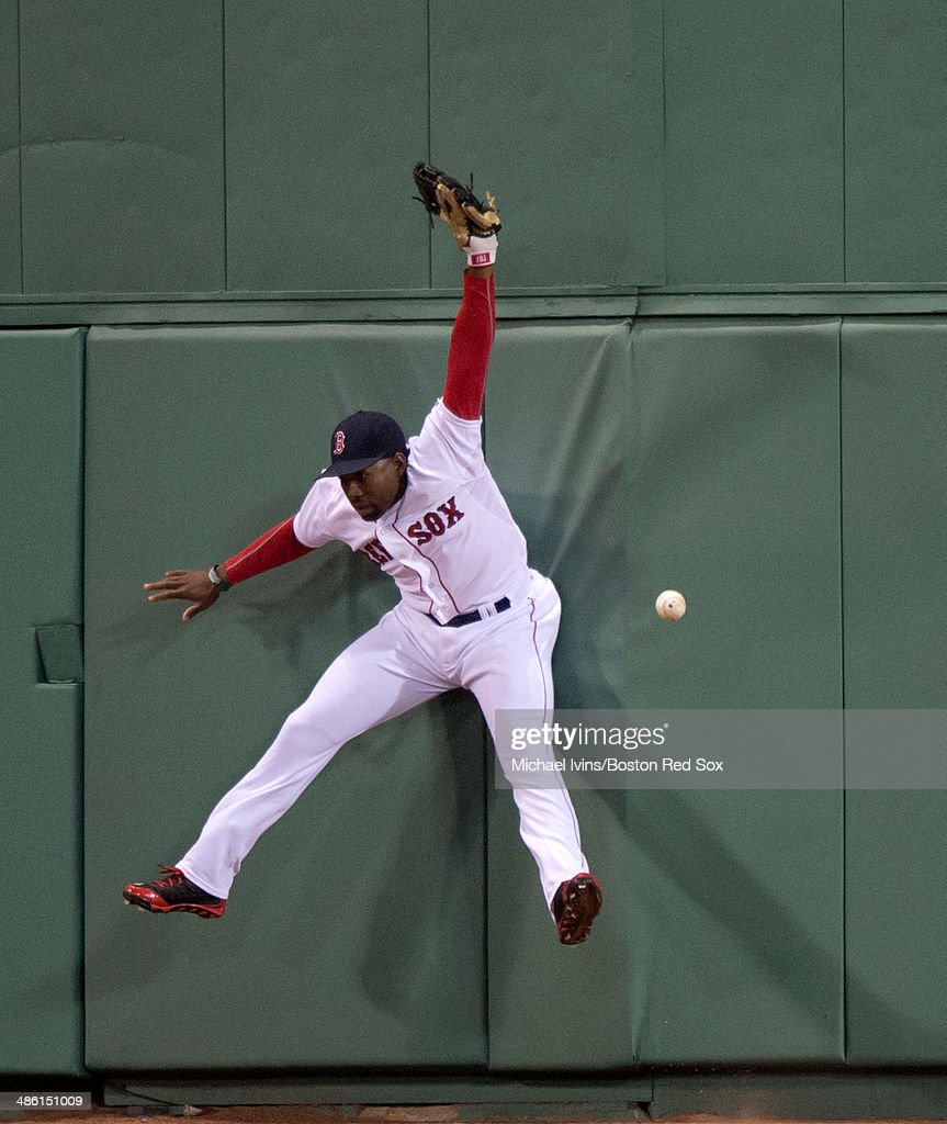 Jackie Bradley Jr. #25 of the Boston Red Sox jumps but can't catch an RBI double off the bat of Brian McCann (not pictured) of the New York Yankees in the fourth inning at Fenway Park on April 22, 2014 in Boston, Massachusetts.