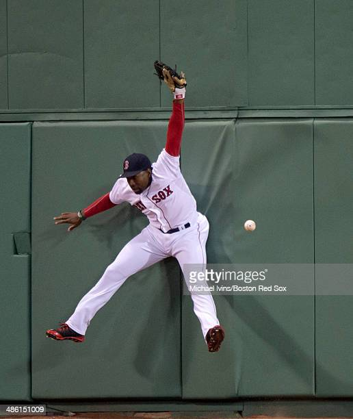 Jackie Bradley Jr #25 of the Boston Red Sox jumps but can't catch an RBI double off the bat of Brian McCann of the New York Yankees in the fourth...