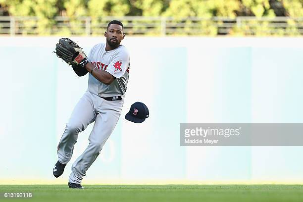 Jackie Bradley Jr #25 of the Boston Red Sox loses his hat as he fields a ball in the second inning against the Cleveland Indians during game two of...