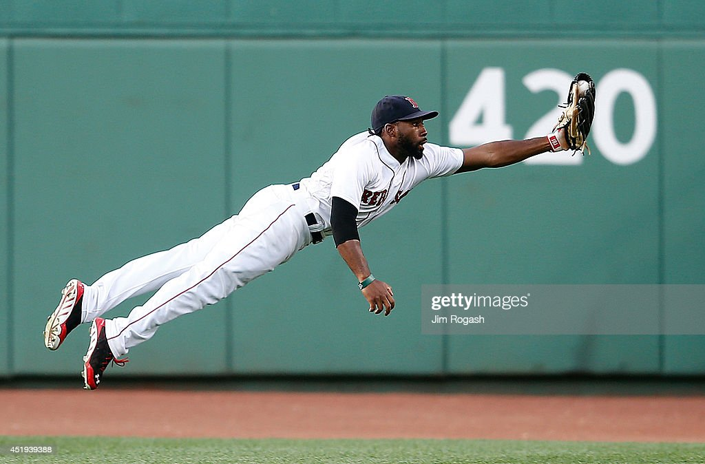 Jackie Bradley Jr. #25 of the Boston Red Sox makes a catch on a ball off the bat of Tyler Flowers of the Chicago White Sox in the second inning at Fenway Park on July 9, 2014 in Boston, Massachusetts.