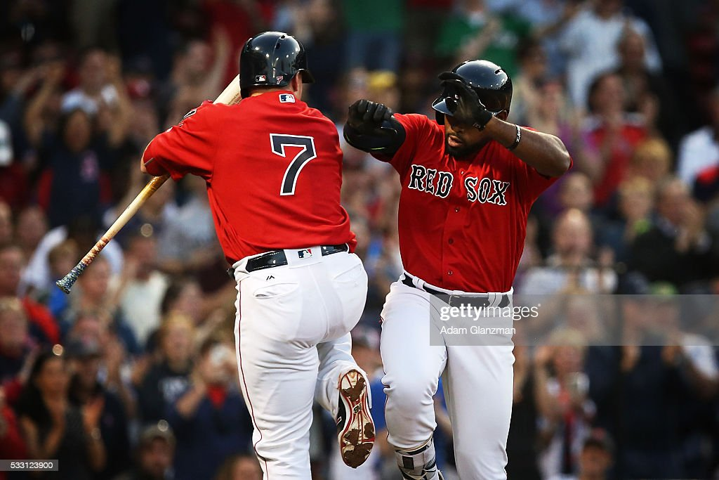 Jackie Bradley Jr. #25 of the Boston Red Sox returns to the dugout after hitting a home run in the second inning during the game against the Cleveland Indians at Fenway Park on May 20, 2016 in Boston, Massachusetts.