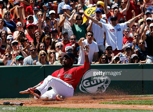 Jackie Bradley Jr. #25 of the Boston Red Sox scores a run against Baltimore Orioles in the second inning during the first game of a doubleheader at...