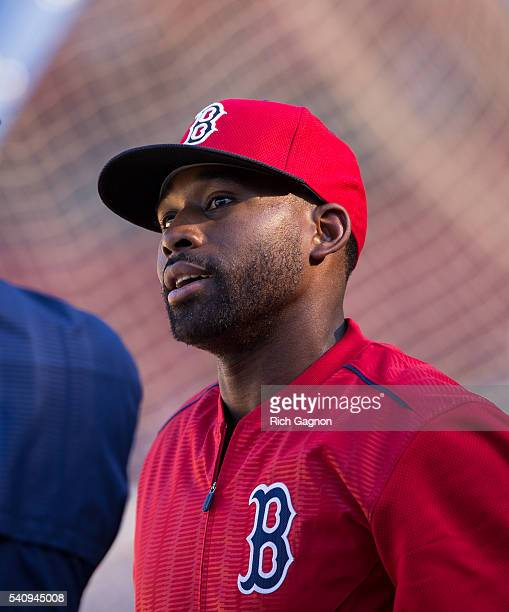 Jackie Bradley Jr #25 of the Boston Red Sox stands behind the batting cage before a game against the Seattle Mariners at Fenway Park on June 17 2016...