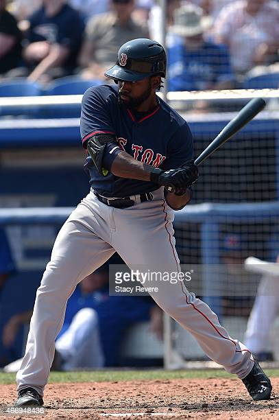 Jackie Bradley Jr #25 of the Boston Red Sox swings at a pitch during a spring training game against the Toronto Blue Jays at Florida Auto Exchange...