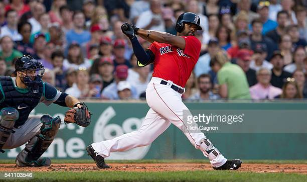Jackie Bradley Jr #25 of the Boston Red Sox swings at a pitch during a game against the Seattle Mariners during the second inning at Fenway Park on...