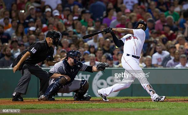 Jackie Bradley Jr #25 of the Boston Red Sox swings at a pitch during the second inning against the New York Yankees at Fenway Park on September 18...