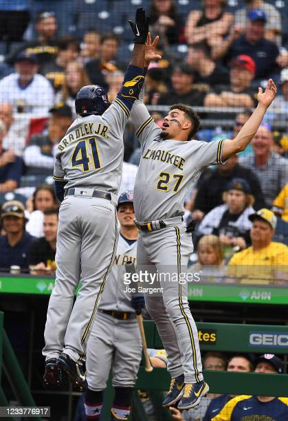 Jackie Bradley Jr. #41 of the Milwaukee Brewers celebrates his solo home run with Willy Adames during the second inning against the Pittsburgh...