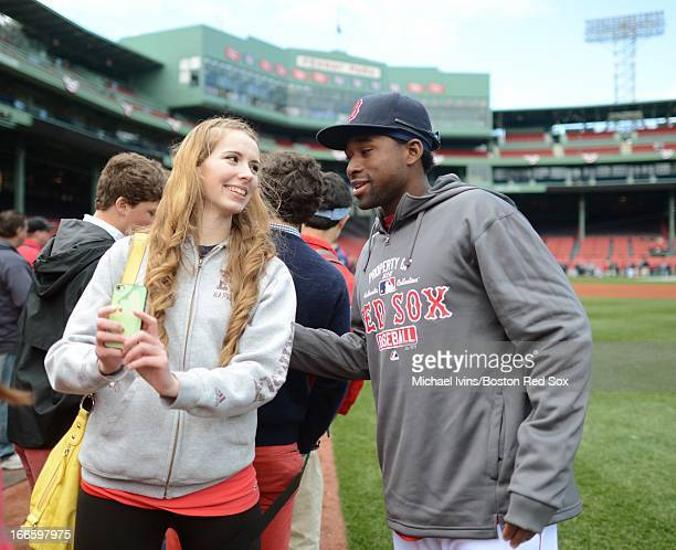 Jackie Bradley Jr #44 of the Boston Red Sox takes a picture with Teala Muir of Abington Massachusetts during 'Player Fan Photo Day' before the start...