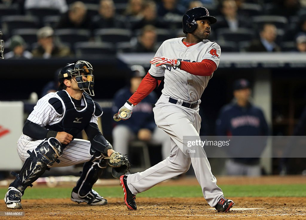 Jackie Bradley #44 of the Boston Red Sox hits an RBI double as Francisco Cervelli #29 of the New York Yankees catches on April 4, 2013 at Yankee Stadium in the Bronx borough of New York City.