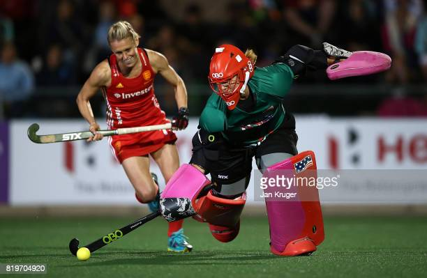 Jackie Briggs goalkeeper of United States of America clears the ball from Alex Danson of England in the shoot out for a win during day 7 of the FIH...