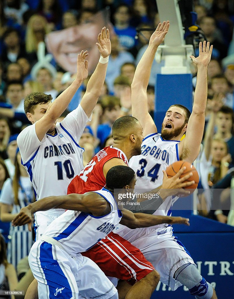 Jackie Carmichael #32 of the Illinois State Redbirds is surrounded by Austin Chatman #1, Ethan Wragge #34 and Grant Gibbs #10 of the Creighton Bluejays during their game at the CenturyLink Center on February 9, 2013 in Omaha, Nebraska.