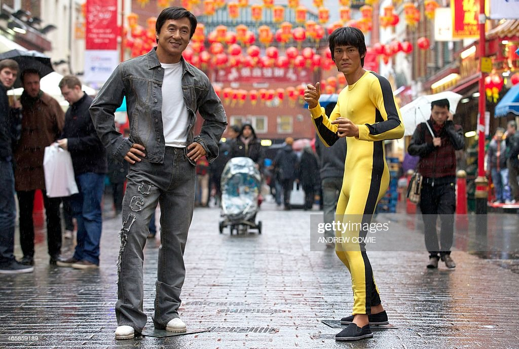 jackie chan and bruce lee wax figures are pictured during