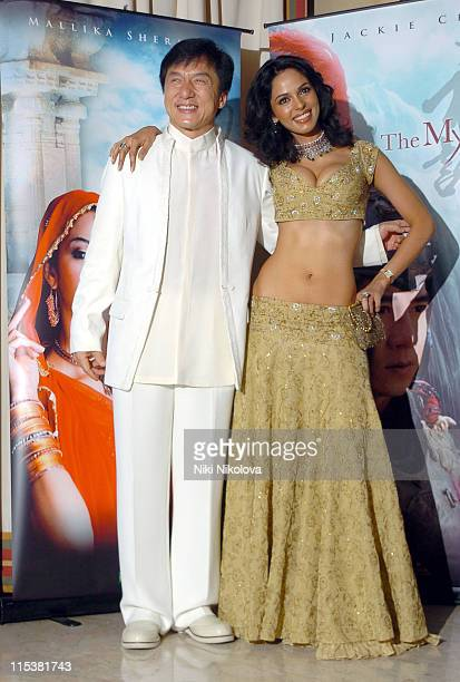 Jackie Chan and Mallika Sherawat during 2005 Cannes Film Festival 'The Myth' Photocall at Majestic Hotel in Cannes France