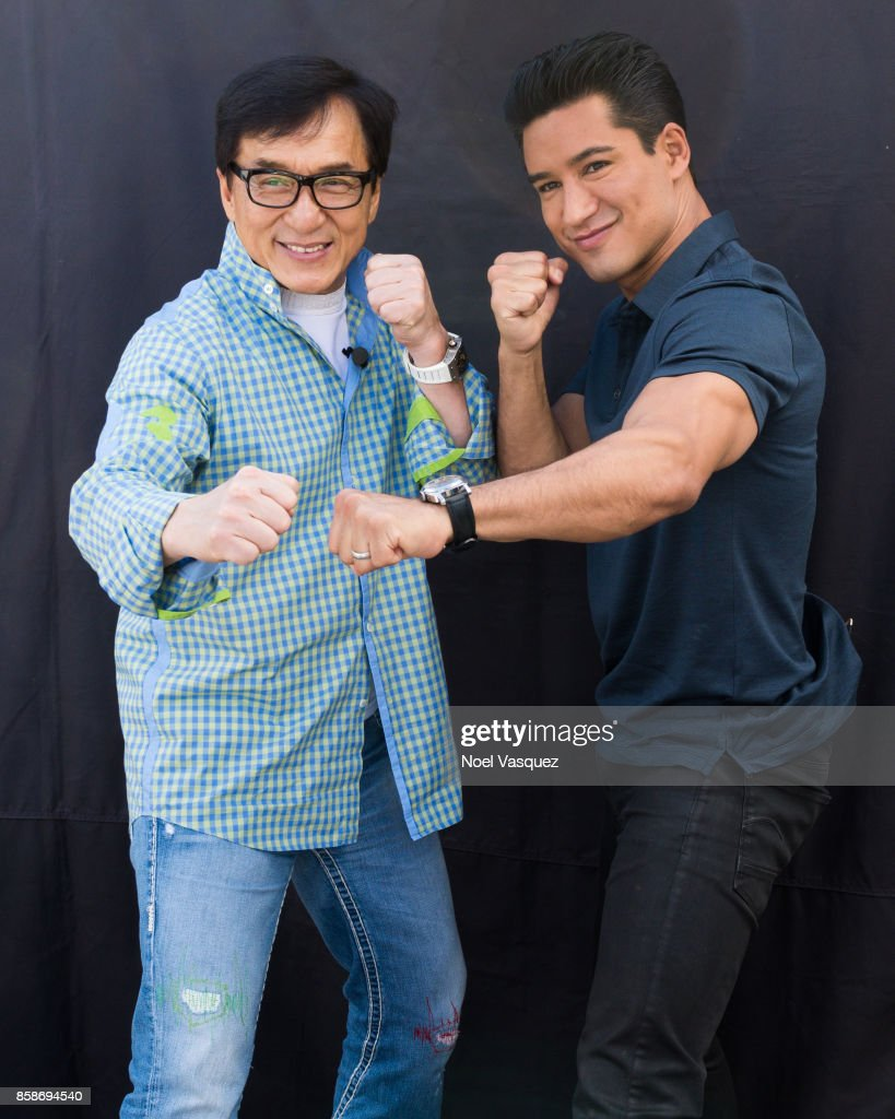 Jackie Chan (L) and Mario Lopez visit 'Extra' at Universal Studios Hollywood on October 5, 2017 in Universal City, California.