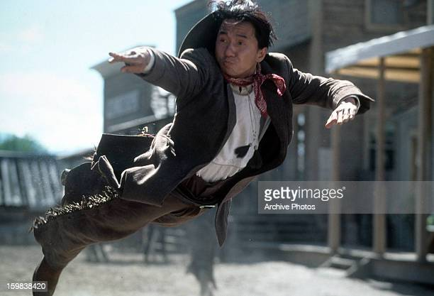 Jackie Chan flying through the air in a scene from the film 'Shanghai Noon' 2000