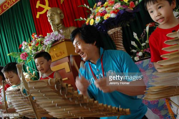 Jackie Chan Playing Xylophones with Children