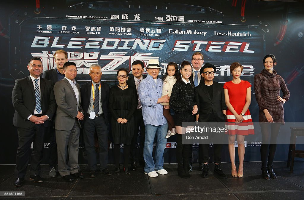 Jackie Chan poses alongside cast and crew during a press conference and photocall for Bleeding Steel at Sydney Opera House on July 28, 2016 in Sydney, Australia.