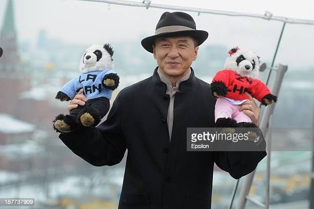 Jackie Chan poses during a photocall for the Russian premiere of 'Armour of God 3' on the roof of the Ritz Carlton Hotel on December 6 2012 in Moscow...